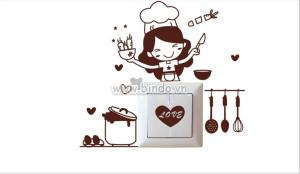 Decal dán tường Dán ổ điện cô gái làm bếp
