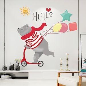 Decal dán tường Gấu chạy xe